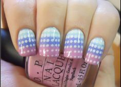 Pink, blue, green pastel sponged gradients with white polka dots, free hand nail art