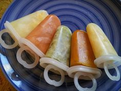 Fruit and baby food popsicles. L to R: mango pieces in pineapple juice, sweet potato, kiwi, squash, and canned pineapple chunks in juice.