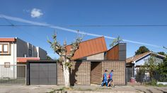 Protruding roof offers skyward views at renovated Chilean home by Felipe Alarcón Carreño