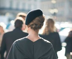 hat and hairstyle, and general style.  This lady looks very pretty and lady-like to me.