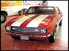 1968 Chevrolet Camaro Z28~Only thing NOT red on this ole girl is her racing stripes!  Red HOT!!