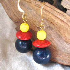 navy, red and yellow dangle earrings by themoonbeam on Etsy https://www.etsy.com/listing/170705283/navy-red-and-yellow-dangle-earrings