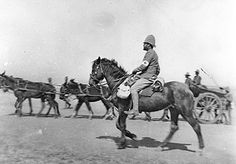 Mounted medical orderly and regimental transport of 2 RCRI on the move.