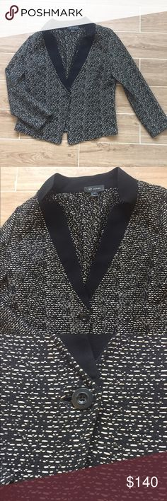 St. John black knit Blazer with exposed stitching Size 14. Super trendy cut. Black poly trim around chest. Middle button. Cream exposed stitching detail, wear open for a totally different look. Too big for me (I'm a xs) but you get the jist of the look! St. John Jackets & Coats Blazers