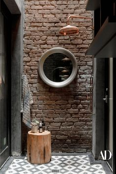"While the notion of bathing outdoors in New York City might seem unappealing, the owner contends it's ""heaven."" But then, her outdoor shower, which was built (on her suggestion) where an air shaft had been, and outfitted with Moroccan tiles and a copper Newport Brass showerhead, is a strikingly unique setup. ""Even when it's snowing outside, it gets steamy in there,"" she says. #outdoorshower #shower #bathrooms #bathroomideas #bathroominspo #tiles #brass #showerhead #mirror #modern #brick…"