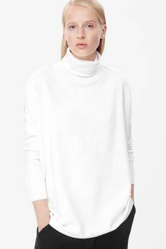 Made from soft cotton jersey with a fleecy underside, this sweatshirt has high ribbed roll-neckline. Wide-cut with rounded proportions, this relaxed style has dropped shoulder seams and slim ribbed 7/8 sleeves.