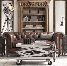 I love and want this lounge. Chesterfield style sofa. Leather!