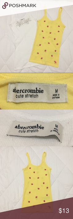 (Medium) Abercrombie Tank Tops Abercrombie & Fitch Tank Tops. Both are Size Medium. I'm 5'1 and 110 lbs and bust size 32B. Good quality. Excellent used condition. Gently worn! Cotton material. Super comfy! White top has beautiful beading detail. Yellow top has fine stitched strawberries. Let me know if you have any questions. — If you'd like only 1 of these tops, I'd be more than glad to create a separate listing of it! Just let me know in the comments. :-) Abercrombie & Fitch Tops Tank Tops