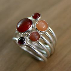 Autumn Leaves Stacking Rings    5 sterling silver stacking rings with a lovely mix of vibrant stones.    8mm burnt orange carnelian  6mm peach