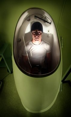 Jonathan Lee, president of the Santa Rosa-based Red Peleton bicycle racing team, sits in a Bodpod at a Sonoma State kinesiology lab. Used to measure levels of body fat, it's part of a study on the effects of caffeine on sports performance. #bodpod #cosmed