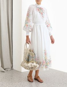 The Zinnia Shirred Long Dress in Ivory Floral from our Resort Swim 2020 Collection. A ramie midi dress with placement floral print and shirred waistband, neck and cuffs. ramie, midi dress with high neck and blouson sleeves, shirred collar, waistband and c High Fashion Dresses, Modest Fashion, Hijab Fashion, Casual Dresses, Short Dresses, Casual Clothes, Simple Long Dress, Modest Maxi Dress, Hijab Evening Dress