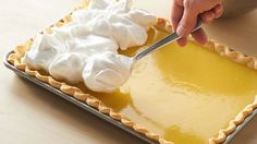 This lemon meringue slab pie is perfect for serving a crowd. Lemon desserts are popular and this pie is no exception—it& great for potlucks and spring gatherings. Lemon Desserts, Lemon Recipes, Pie Recipes, Just Desserts, Dessert Recipes, Cooking Recipes, Potluck Desserts, Drink Recipes, Mousse