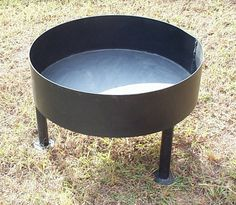 An above ground fire pit that can also be used as a grill.  I like that this one is so simple, just bare bones.  #fireplace #firepit #fire