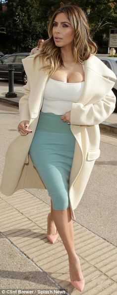 Immaculate: Kim's hair and make-up were flawless, even though her outfit ensured no one would have been looking at her face