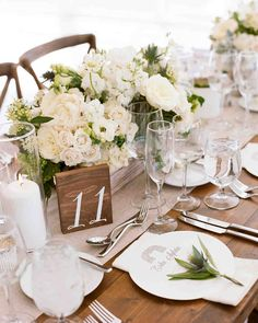 An Elevated Countryside Wedding in Wyoming | Martha Stewart Weddings - Cream and white roses, peonies, and scabiosa, accented with greenery served as centerpieces while a spring of thistle adorned the unique round menus on each place setting.