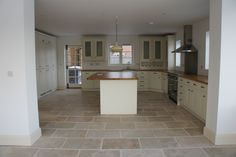 These gorgeous Rustic Travertine tiles have been used in this fab kitchen to create an amazing family space. We love the cream units against the warm rustic floor tiles.