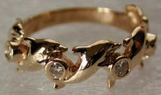 gold and diamonds dolphin ring