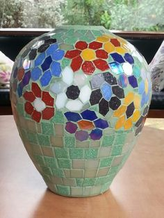 Mosaic vase by Iris Bello