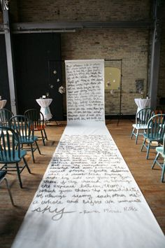 Awesome idea - Ceremony backdrop handwritten by the bride and groom on a long roll of butcher paper!!!
