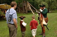 A Hessian soldier talks to park visitors during the Under the Crown event at the Living History Park