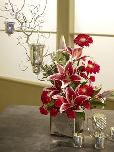 GORGEOUS arrangement using #mercuryglass. See the DIY video: http://ubloom.com/blog/2012/10/07/how-to-create-a-special-event-centerpiece-with-mercury-glass/ @J Schwanke #ubloom