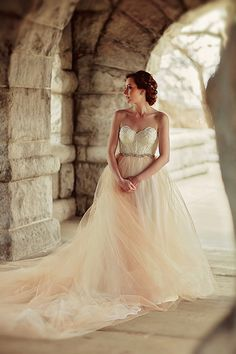 romantic wedding gown with blush train and removable skirt