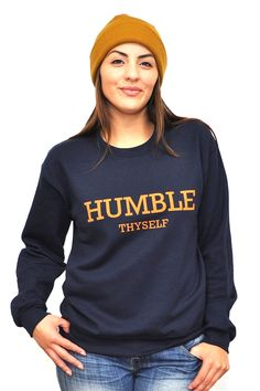 Inspired by James 4:10 Humble yourselves before the Lord, and he will exalt you. This is a a Navy Blue Unisex Sweatshirt that has a front/back design. The text color is orange.