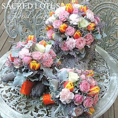 Wedding bouquet posy seasonal mix colourful pastel garden rose carnations tulips