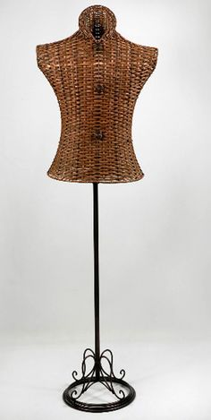 """64"""" on a adjustable metal stand. Bust is 34"""" waist 20"""" and hip is 45"""" .This dress form is made in brown wicker wood and wrought iron. 79 dollars"""