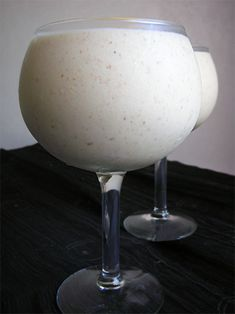 Coconut Tropical Bliss Smoothie recipe  Almond Milk: •1/2 cup raw almonds  •1 1/2 cups distilled water   Mix ins: •frozen bananas  •fresh pineapple  •coconut cream concentrate to taste  •1 tablespoon coconut oil   Blend nut milk in a high-speed blender. Add remaining ingredients and blend until thoroughly mixed.  Adjust ingredients to desired taste and thickness.