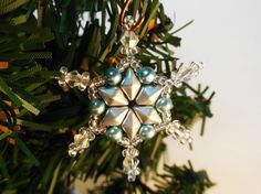 The Holidays are all about celebrating special moments and creating memories. Add your own personal touch to the holiday decor in your home with the beaded Snowflake Ornament tutorial.  This simple snowflake beading pattern is quick and easy. You can whip up several snowflakes in hardly any time at all! Hang these DIY Christmas ornaments on your tree or even on garlands over the fireplace.  Once completed, the Snowflake Ornament will measure approximately 1.5 inches (3.8 cm).  The purchase…
