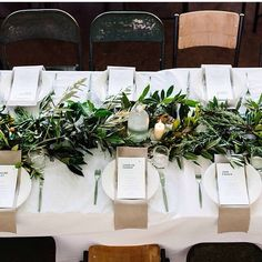 love leave garland interspersed with candles as centerpiece