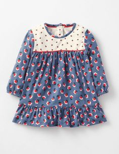 This little dress could have come straight out of the Seventies. With a ditzy print and floaty shape, it has a vintage-inspired style. The soft jersey fabric will keep your little hippy chick cosy, and it's throw-in-the-wash durable too.