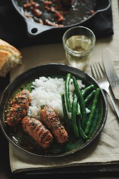 Greek Soutzoukakia: Greek sausage-shaped meatballs.