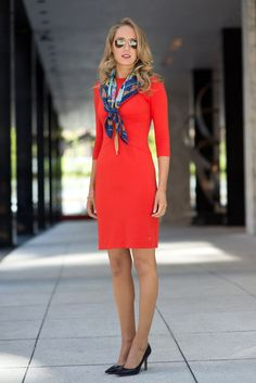 red sheath dress with scarf and black pumps