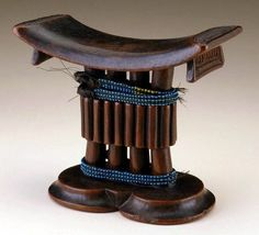 Africa | Headrest from the Shona or Tsonga people.  Zimbabwe, Mozambique or South Africa | Wood, glass beads and plant fiber | ca. early to mid 1900s.