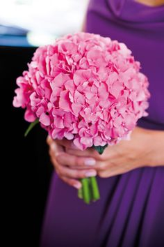 We love this gorgeous hot pink hydrangea bouquet! For more of Charlotte and Steve's modern real wedding, click here! #weddingideas