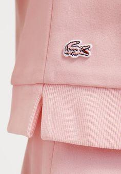 Preppy Femme Lacoste Izod rose bush pink on pink Mode Man, Parisienne Chic, Clothing Labels, Mode Inspiration, Fashion Labels, Fashion Branding, Fashion Details, Lounge Wear, Knitwear