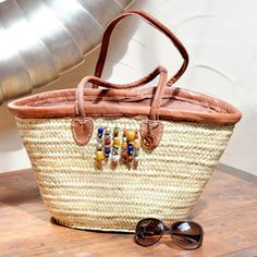 Krobo beads, 100% Moroccan leather and a handmade woven palm leaf bag combine in our Boho Bead women's tote shoulder bag - Solamante