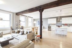 NYC Apartment Featuring Massive Exposed Wood Beam - http://www.usualhouse.com/nyc-apartment-featuring-massive-exposed-wood-beam/