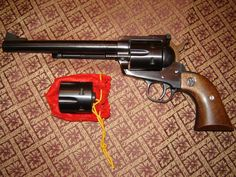 Ruger Blackhawk--.45LC & .45 ACP--1977 this will stop anything in their tracks.