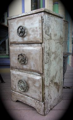 """Steam-Punk Style Dresser 14"""" w x 11"""" d x 27"""" t $185.00 ...the finish is silver foil with an expresso glaze...."""