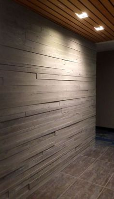 These striking board form concrete walls offer the classic look of wood with the durability of concrete. Concrete-Visions created these for Fransen-Pittman's new office in Englewood, CO.