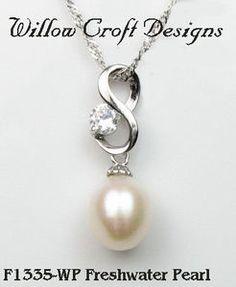 Accessoires mariée - Pendentif perle, arabesque et oz en argent 925 - 30€