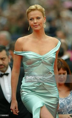 Actress Charlize Theron wearing Chopard jewelry arrives to the closing night ceremony and the screening of 'De-Lovely' during the 57th Cannes Film Festival on May 22, 2004 in Cannes, France.
