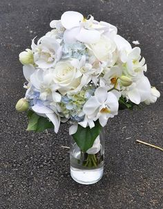 Pearl - whit phaelanopsis orchids, white roses and blue hydrangeas