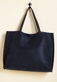 Get the Cargo-Ahead Bag in Navy. This faux-leather bag is ready for action when you are, so take its head-turning texture on the move. #blue #modcloth