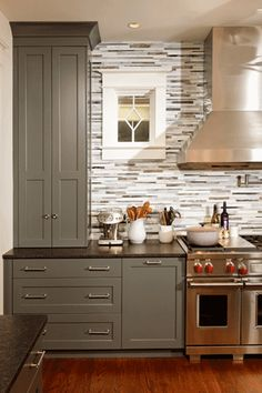 I'm not sure why but I like the grey cabinets with the dark wood floors and the stainless steel appliances, I'd have to do a tile backsplash with a little more umph to tie it all together.