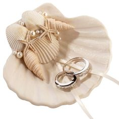 The beach themed wedding Seashell Resin Wedding Ring Holder is decorated with shells and pearls, perfect way to incorporate the essence of the the ocean into the wedding ceremony without the mess.
