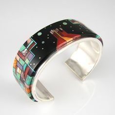 "Cuff | Bryon Yellowhorse. (Navajo). ""Monument Valley Night Sky"".  Sterling silver, with Mosaic Inlaid Black Jade, Turquoise, Coral, Spiny Oyster Shell, Gaspeite, Sugilite, and Picasso Marble."